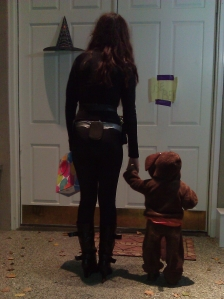 photo of teen and toddler trick or treating