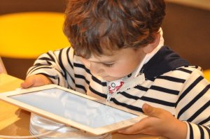 a child looking at a mobile device